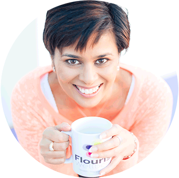 Prabha Shiyani with Flourish Wellbeing mug